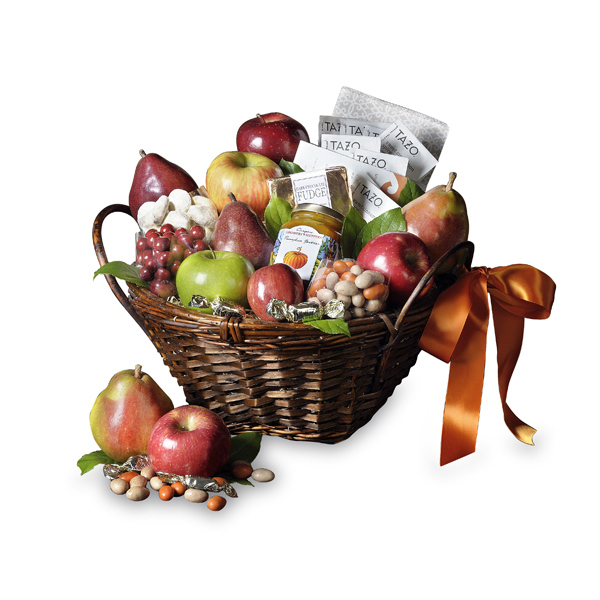A tisket, a tasket, there's nothing like this Thanksgiving basket! It's gobble gobble all the way with all your favorite fall fruit and gourmet items. 2 Fuji, 1 Granny Smith, 1 mini and 2 Honeycrisp apples, 2 Comice and 2 Red D'Anjou pears, pumpkin pecan tea cookies, decadent dark chocolate fudge, caramel apple chews, pumpkin spice almonds, mint truffle creams, pumpkin butter, and Tazo sweet cinnamon spice tea. Comes decorated in brown and orange colors.